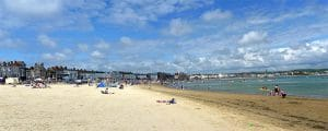 Cropped image courtesy of https://commons.wikimedia.org/wiki/File:Weymouth_beach_in_July_2011.jpg